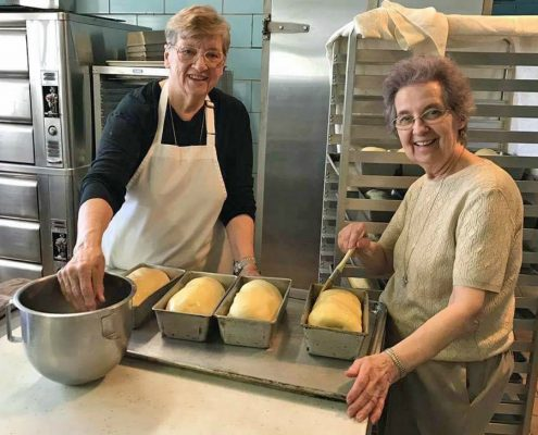 Sisters Christopher and Michaelette Baking Bread